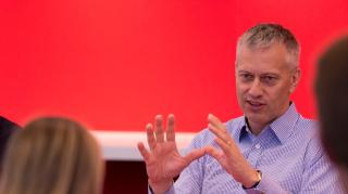 James Quincey speaks to a Coca-Cola colleague at the company's Atlanta headquarters.